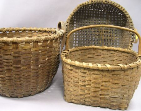Three Woven Splint Gathering Baskets.