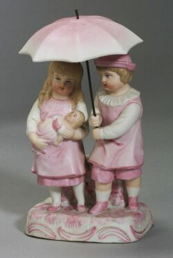 Bisque Figure of Boy and Girl with Umbrella