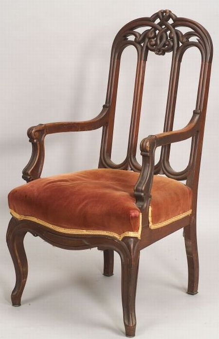 Gothic Revival Rosewood Carved Upholstered Armchair, probably New York, 1850-1870, the pierced intertwined crest continues to molded st