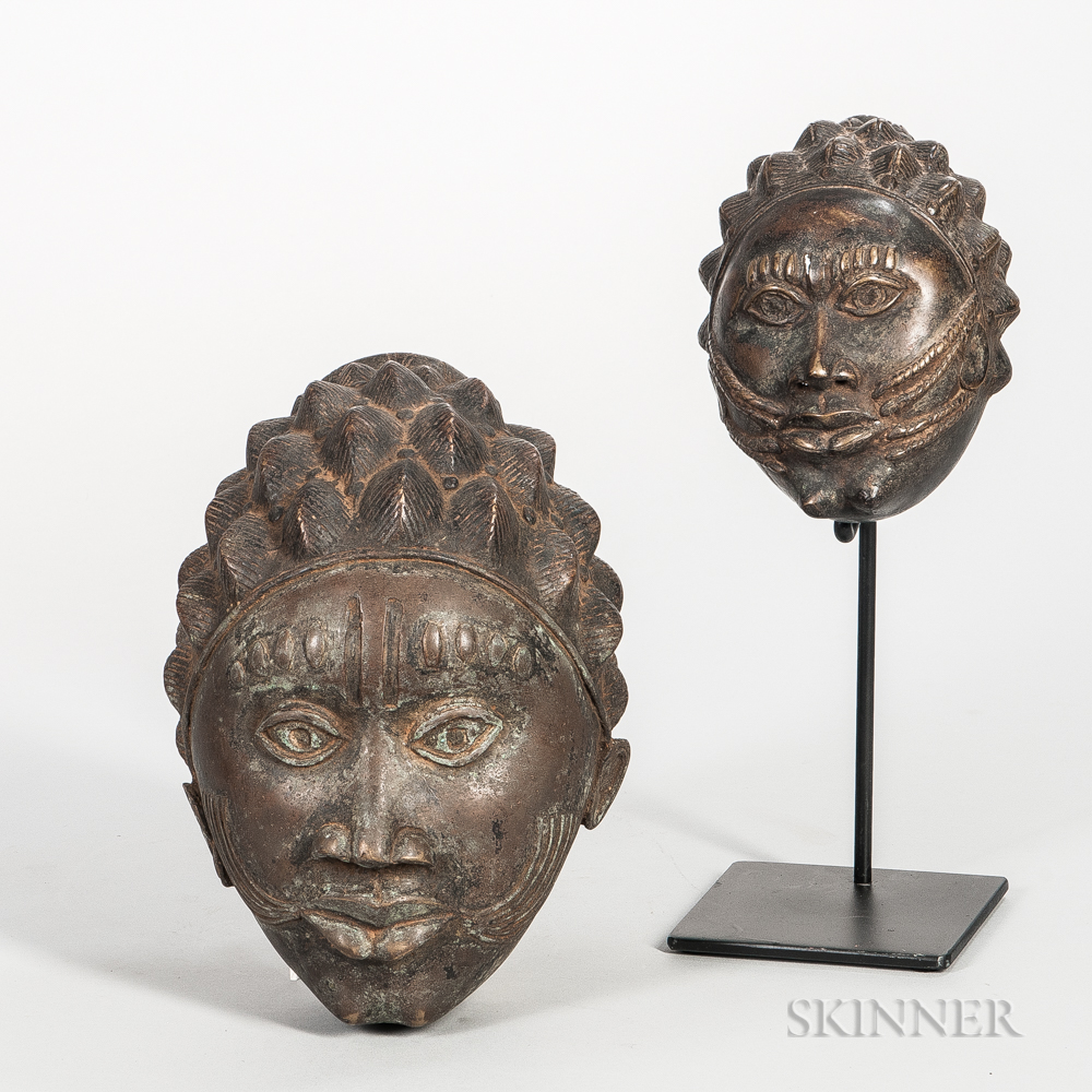 Two Bronze Female Masks