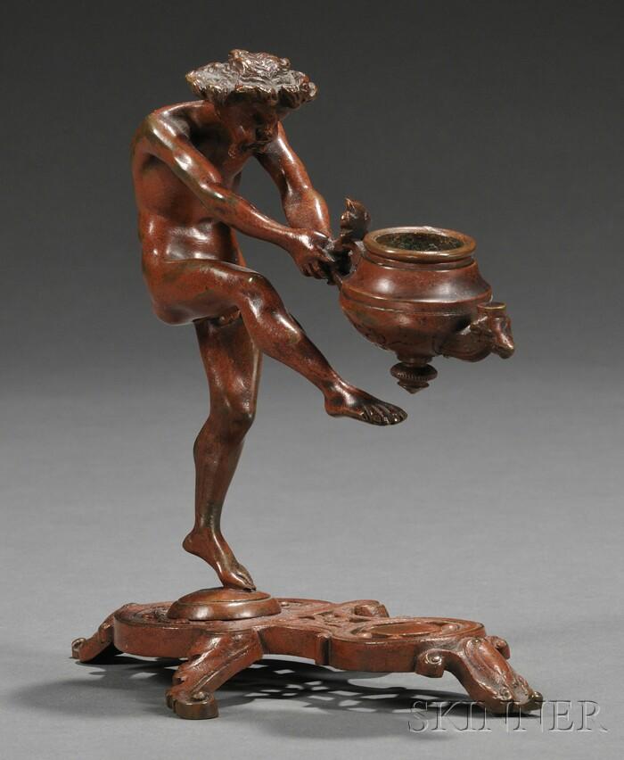 Figural Bronze Candle Holder