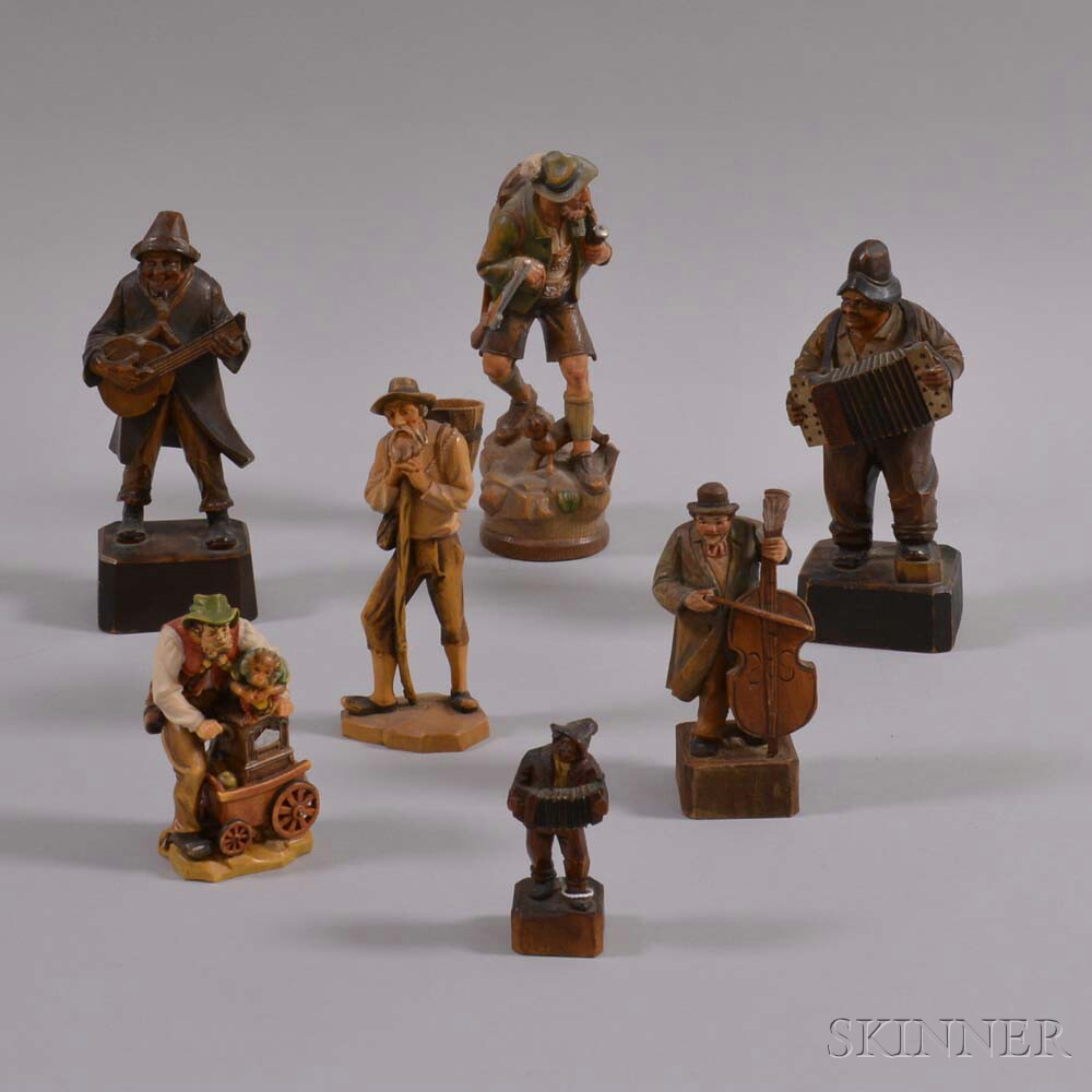 Seven Small German Carved and Painted Figures