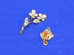 One Gold Pins and an Enamel Pendant.
