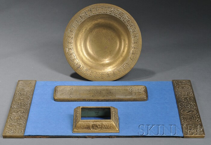 Four Tiffany Studios Zodiac Pattern Desk Articles and a Bronze Bowl