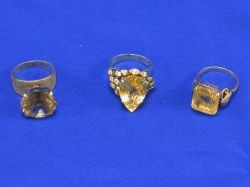 Three Gold and Citrine Rings.