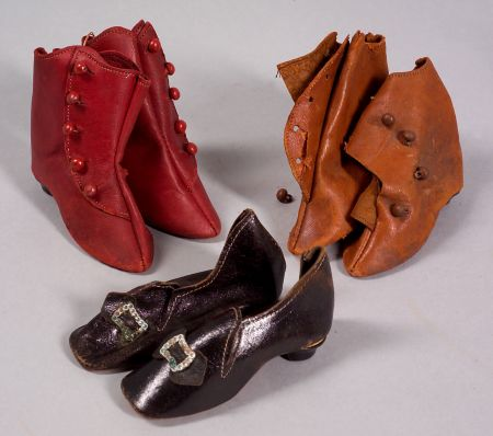 Three Pairs of Heeled Boots and Shoes