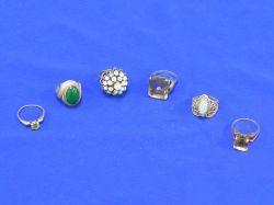 Seven Gold Gem-set Rings.