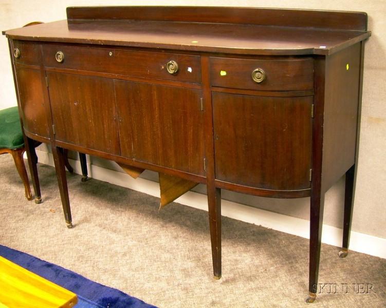 Paine Furniture Mahogany and Mahogany Veneer D-shaped Sideboard.