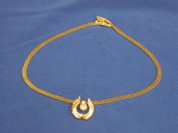 14kt Italian Gold Chain with a Trans-cut Diamond Solitaire