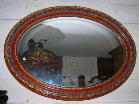 Two Parcel-gilt Framed Oval Mirrors