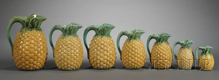 Seven Graduated Mintons Majolica Pineapple Pitchers