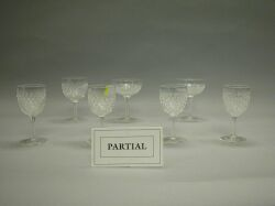 Twenty-four Colorless Cut Glass Champagne and Sherry Glasses.