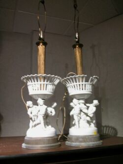 Pair of White Porcelain Putti and Fruit Basket Figural Table Lamps.