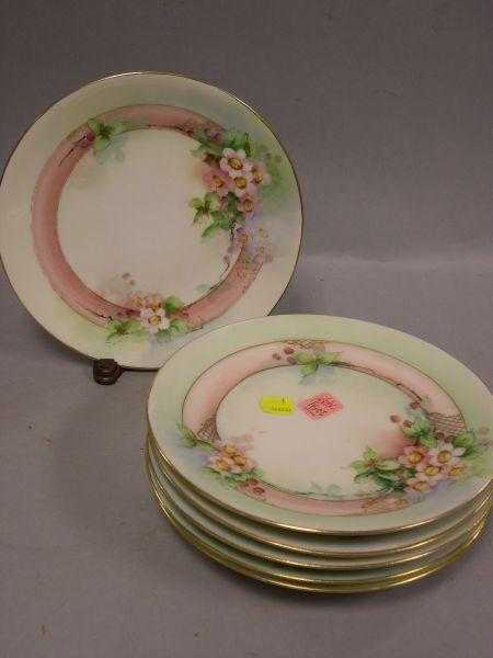Set of Six Limoges Handpainted Floral Decorated Porcelain Plates.