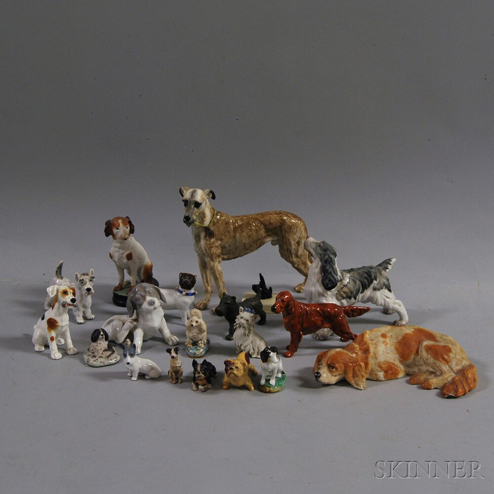 Nineteen Ceramic and Metal Dog Figurines