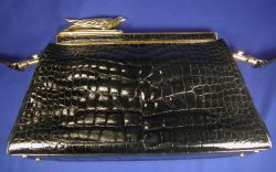 Vintage Alligator Handbag, Judith Leiber, the tapered rectangular bag with gold tone frame, closure as stylized falcon, removeable leat