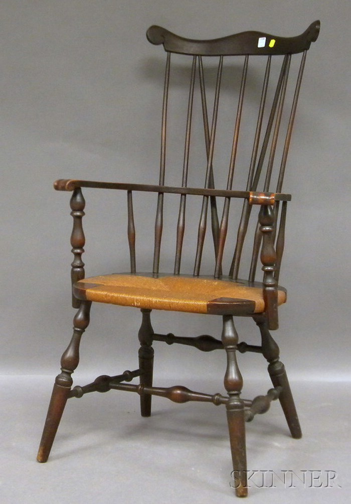 Colonial Revival Windsor Carved Maple Brace-back Knuckle Armchair.