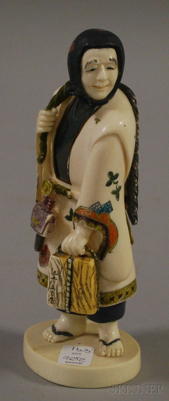Japanese Carved and Painted Ivory Tusk of a Fishmonger