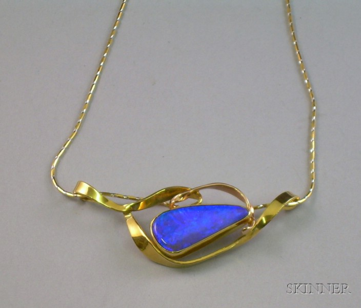 14kt Gold and Opal Modern Free-form Pendant and an 18kt Gold Chain.
