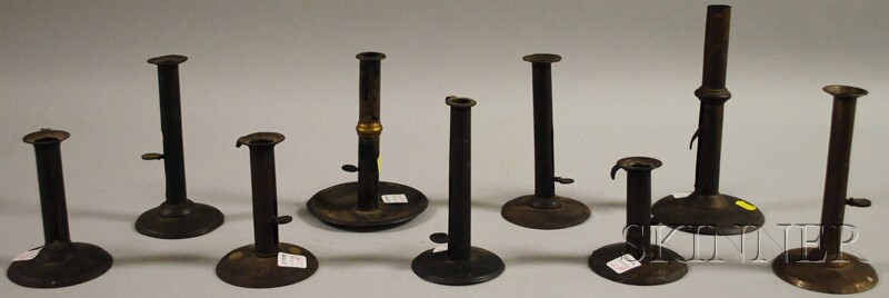 Nine Assorted Sheet Iron Push-up Hogscraper Candlesticks