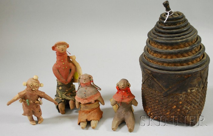 Four Ceramic African Dolls and a Set of Nesting Baskets
