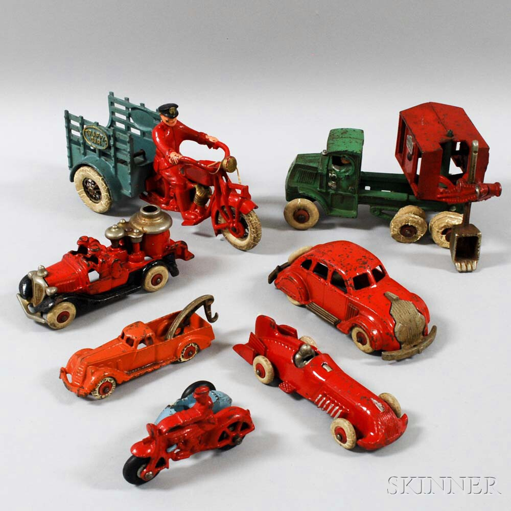 Seven Cast Iron Vehicles