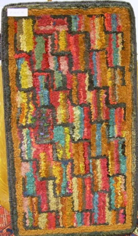 Three Matching Mounted Shirred Wool and Cotton Geometric Hooked Rugs.