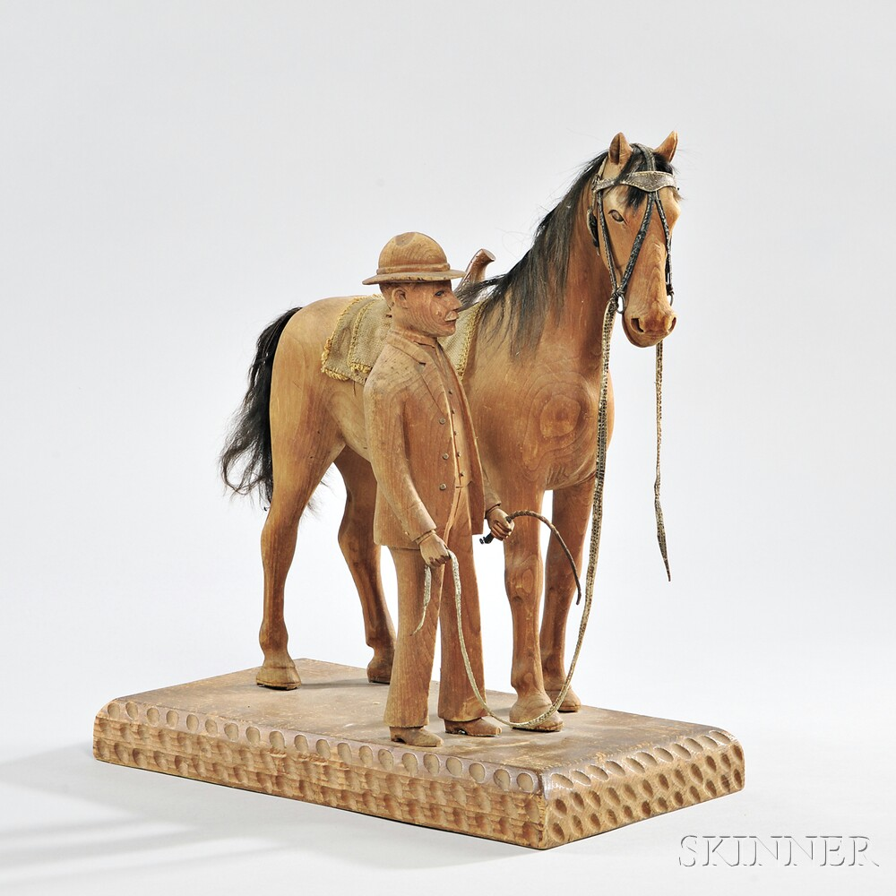 Carved Pine Figural Group of a Man and His Horse