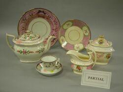 Sixty-five Piece Assembled Pink Lustreware Partial Tea Service.