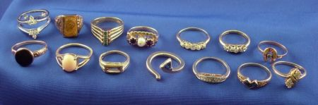 Fourteen 14kt Gold and Stone Inset Rings