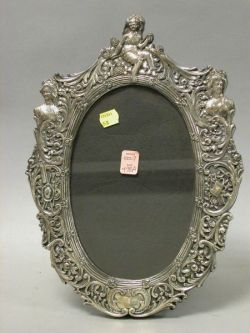 Oval Repousse Sterling Silver Picture Frame.