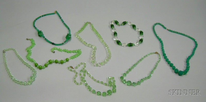 Eight Art Deco and Later Green Glass and Crystal Beaded Necklaces.
