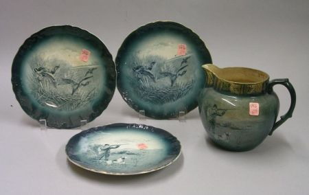 """Buffalo Pottery """"The Gunner"""" Jug and Plate, and a Pair of Wild Ducks Plates"""