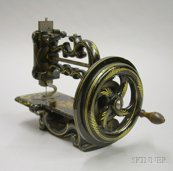Small Cast Iron Sewing Machine by Louis Beckh