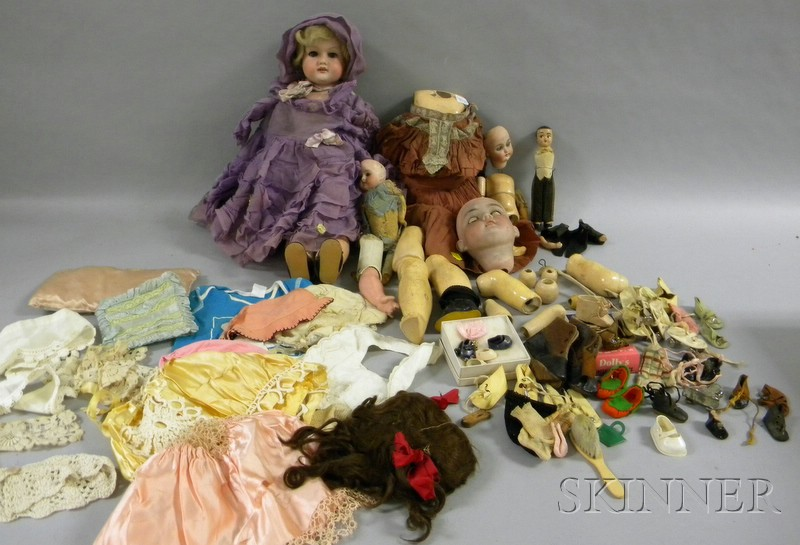 Three Partial German Dolls and Assorted Doll Clothing