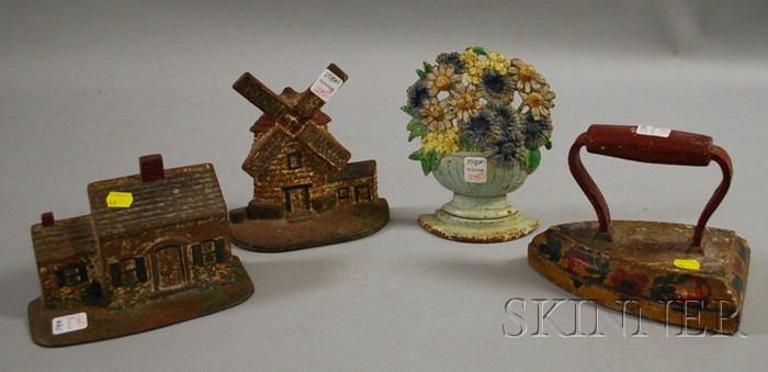 Four Painted Cast Iron Doorstops