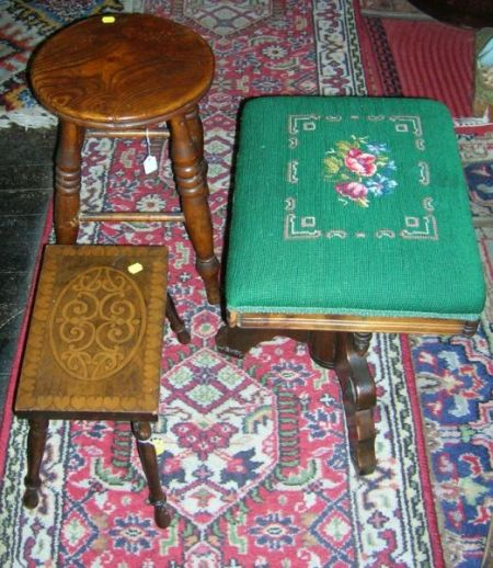 Victorian Elmwood Stool, Needlepoint Upholstered Walnut Stool, and a Pyrography Decorated Wooden Stool.