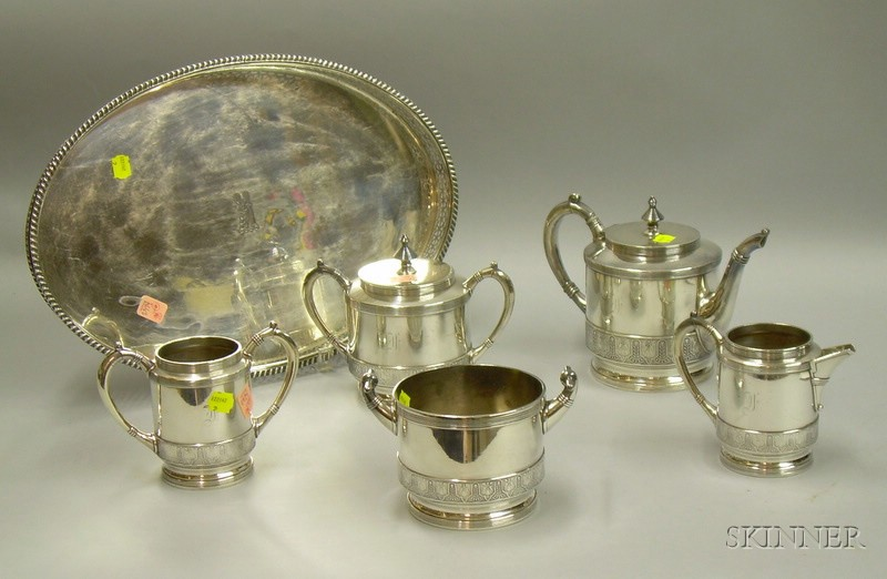 Five-piece Meriden Aesthetic Silver Plated Tea Set and an Oval Silver Plated Tray with Pierced Gallery.