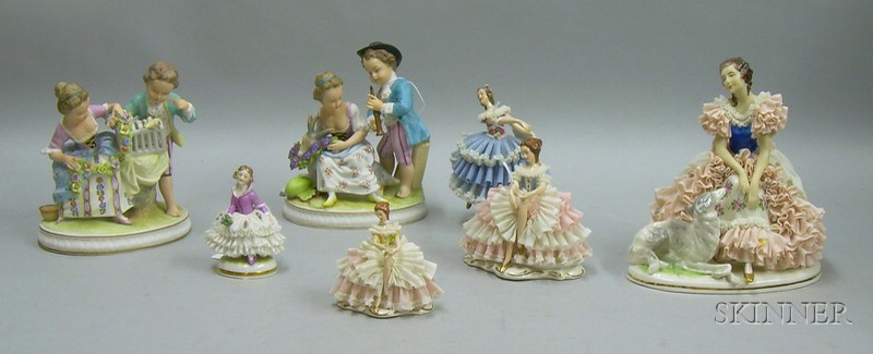 Five German Porcelain Crinoline Figures and a Pair of German Painted Bisque Figural Groups.