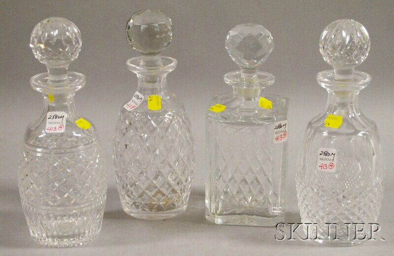 Four Colorless Cut Glass Decanters