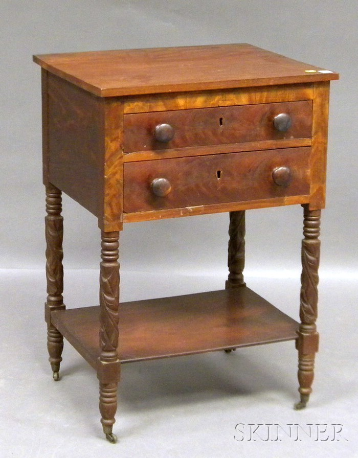 Classical Carved Mahogany and Mahogany Veneer Two-drawer Work Table.