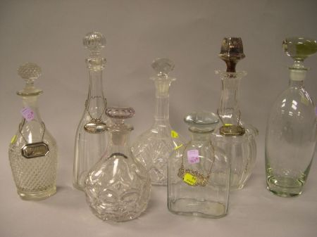 Seven Colorless Molded and Cut Glass Decanters.