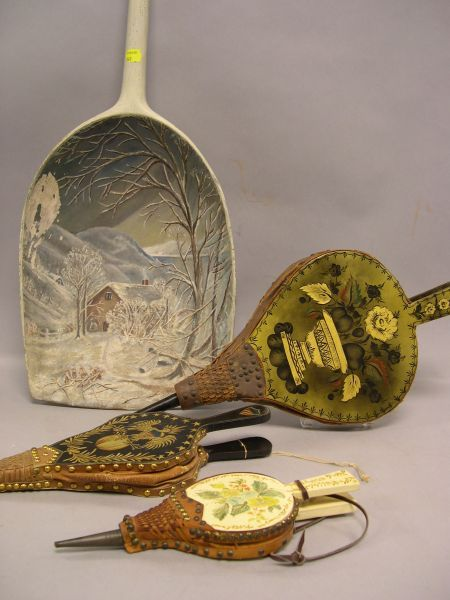 Three Paint Decorated Wooden Bellows and a Painted Winter Scene Grain Shovel.