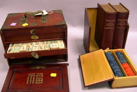 Leather Bound Book-form Poker Chip Box and an Asian Brass Bound Hardwood Cased Ivory Mahjongg Set.