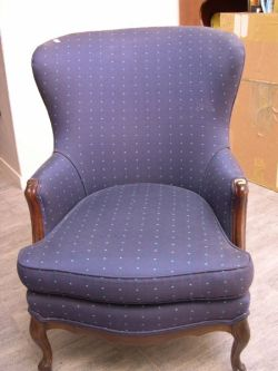 Rococo Revival Walnut and Upholstered Barrel-back Parlor Chair.