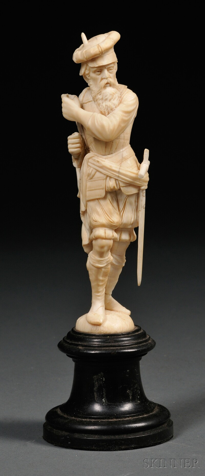 Carved Ivory Figure of a Man with a Sword