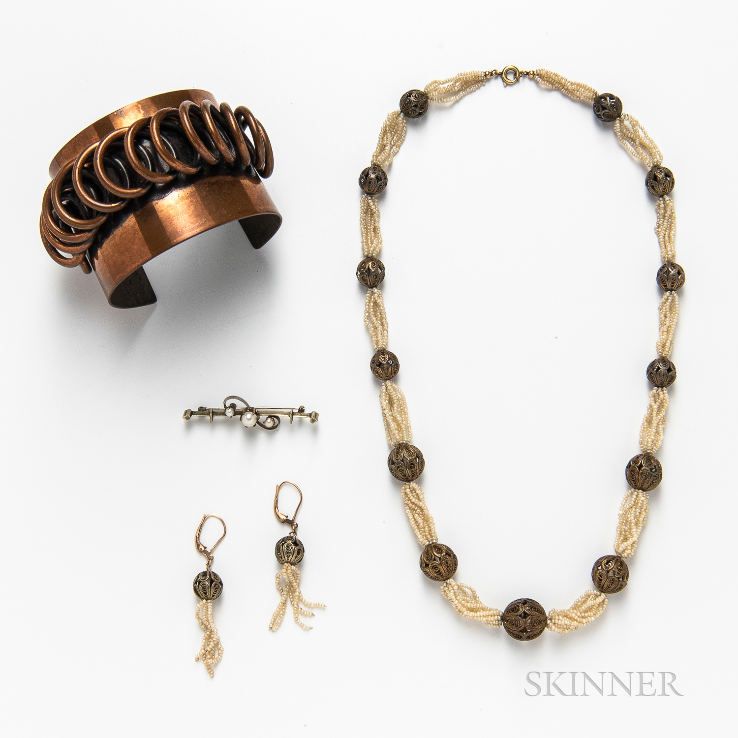 Rebajes Copper Cuff, a Pearl-set Brooch, a Silver-plated Hairpin, and a Seed Pearl and Filigree Bead Necklace and Earring Suite