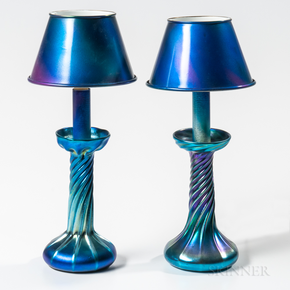 Two Tiffany Studios Blue Favrile Candlesticks with Painted Metal Shades