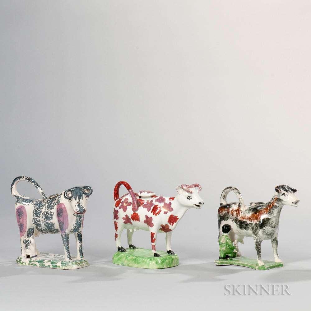 Three Staffordshire Pottery Cow Creamers