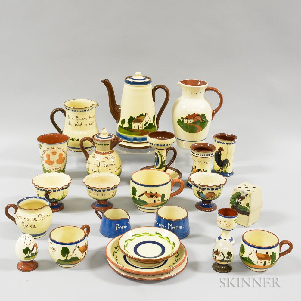 Twenty-four Mostly Watcombe Torguay Pottery Mottoware Items.
